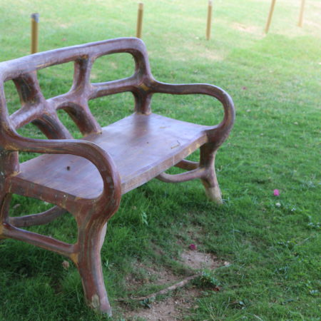 Sit a spell and relax on this carved wooden bench.